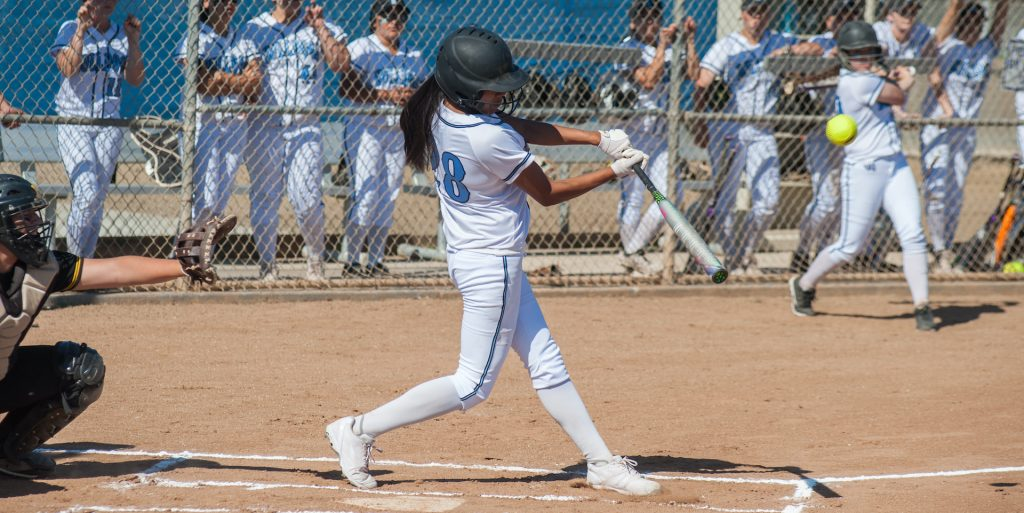 fast pitch softball hitter at contact