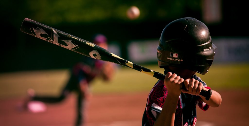 youth baseball hitter watching pitch